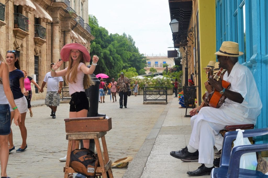 Tourists dance salsa in Havana's streets to the sound of live musicians